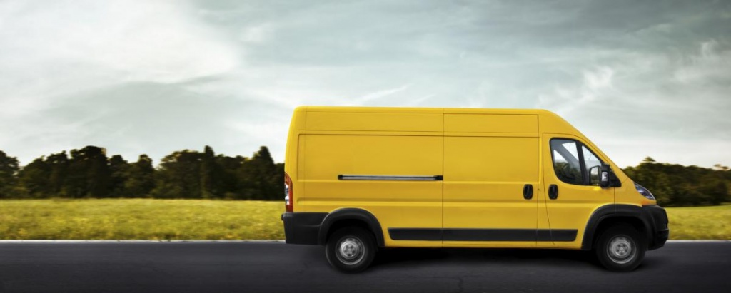 courier_on_the_road_in_yellow_freight_van.jpg